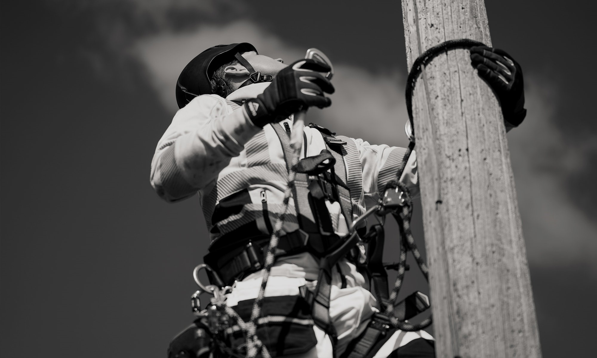 height worker climbing a pole