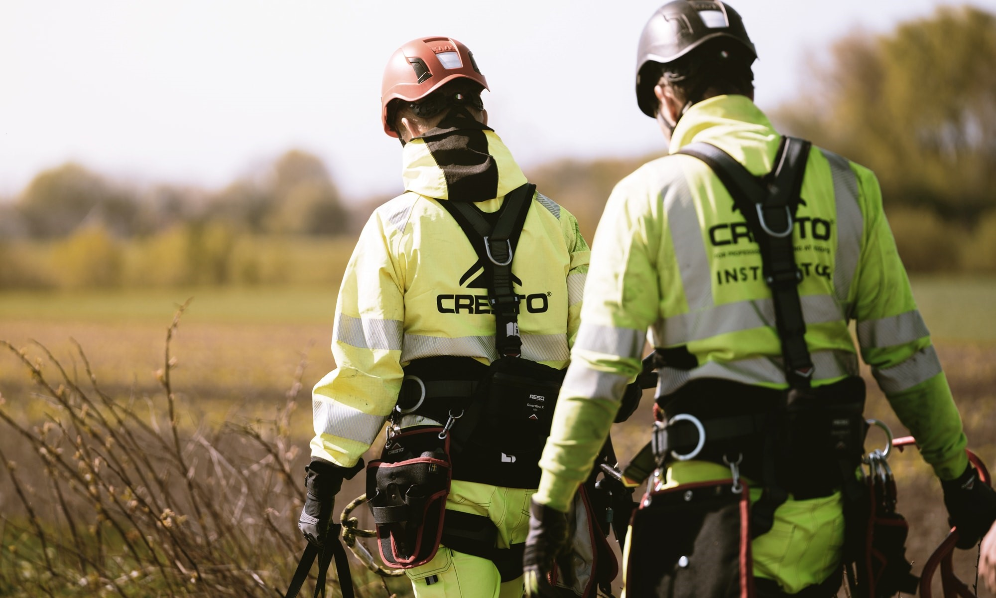 Two workers in high visibility clothes